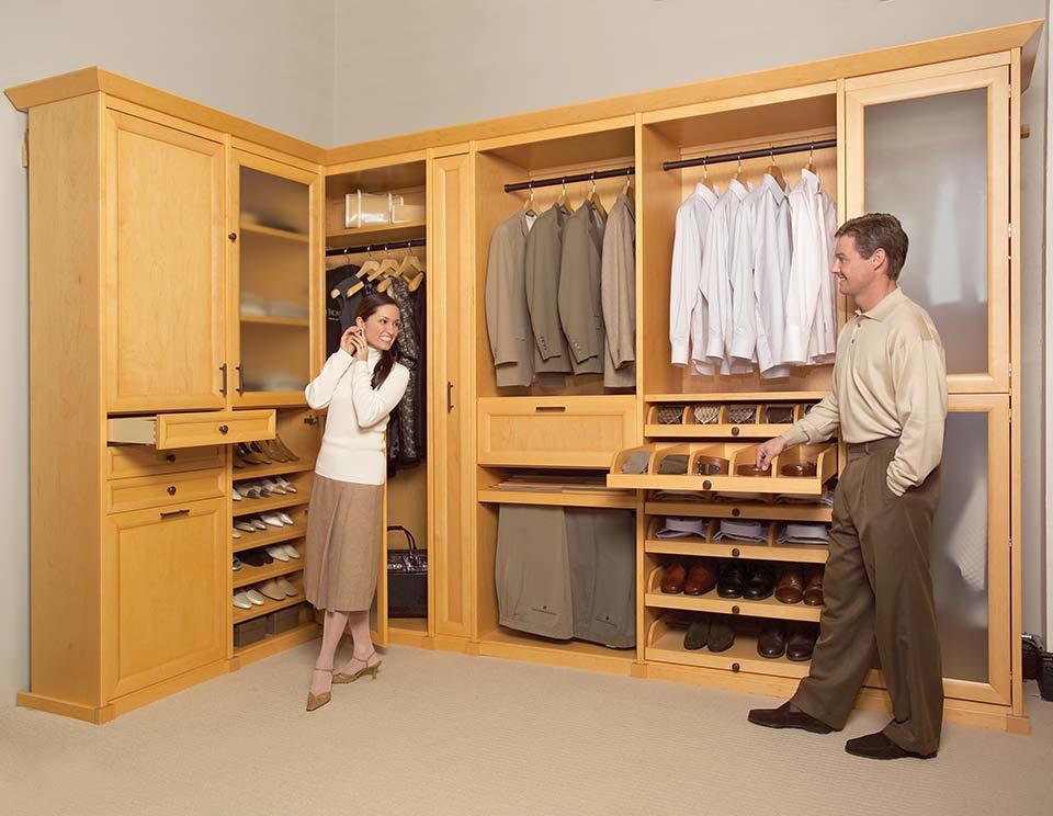 custom walk in closet, man and woman getting ready, cherry wood