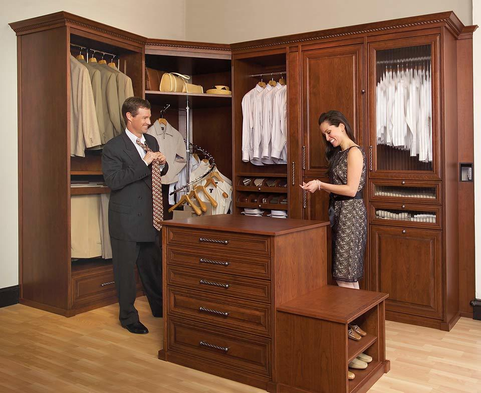 custom walk in closet, man and woman getting ready, island, cabinets